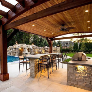 covered patio with bar and pool